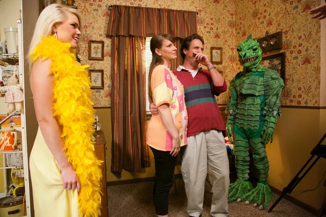 IMAGE: Behind the scenes photo with actors and green monster