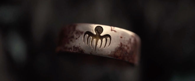IMAGE: Still – SPECTRE logo on ring
