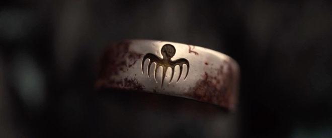 IMAGE: Still –SPECTRE logo on ring