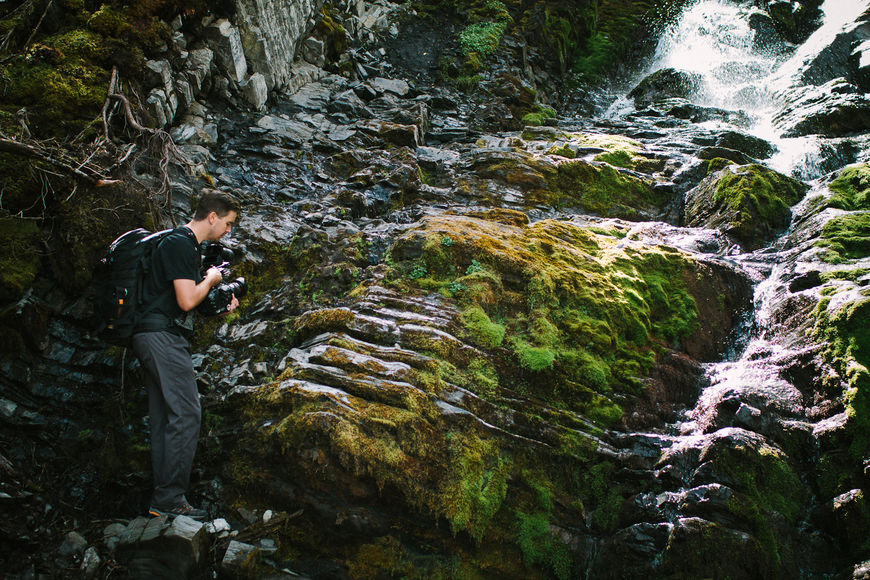 IMAGE: Photograph – Steve Seeley filming a waterfall
